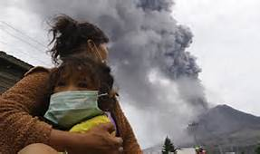 Women with child under mount Sinabung Smoke